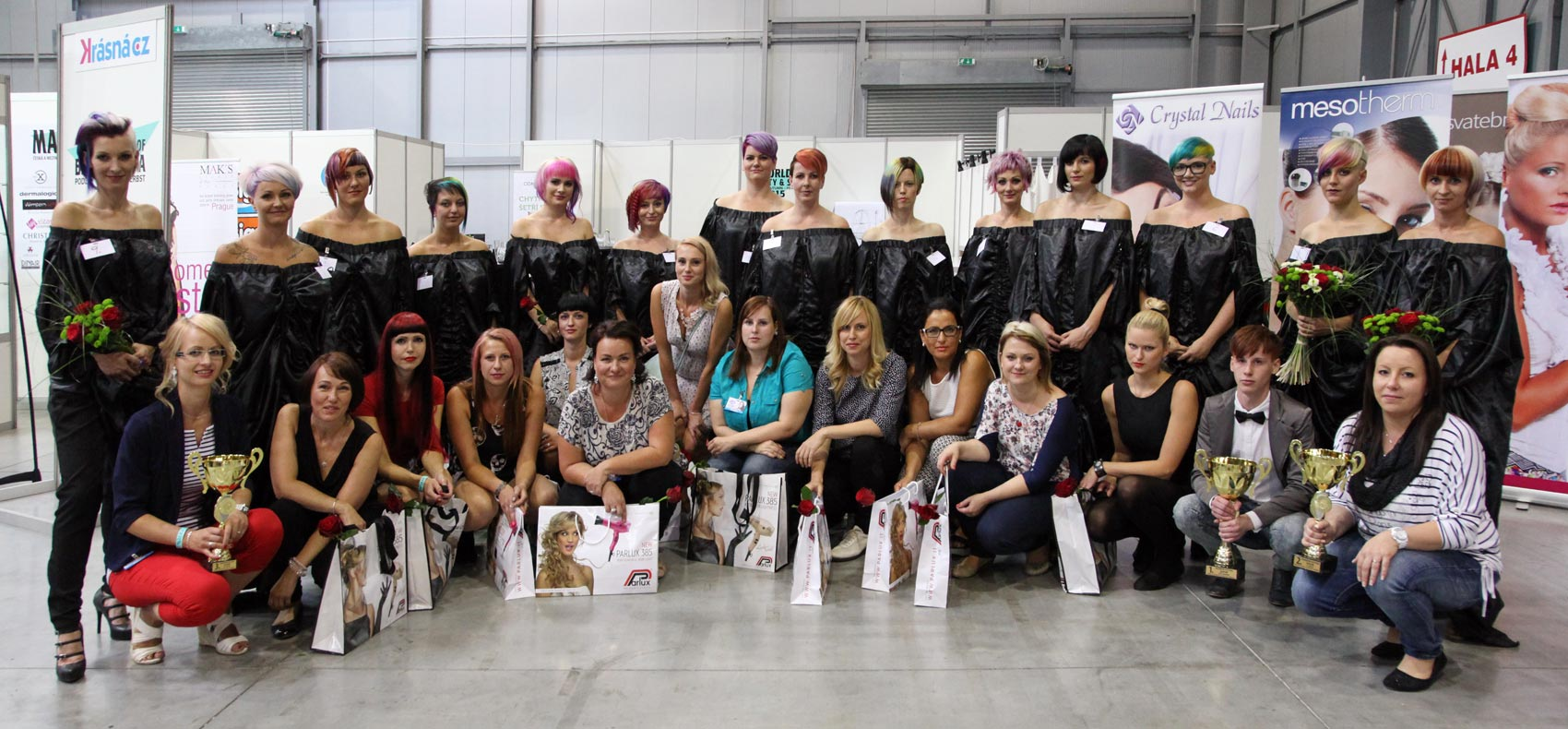 Participants of hairdressing competition World of Beauty & Spa – Inspiration 2016 with their models and hairstyles.